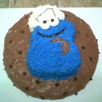 Cookie Monster On A Cookie Chocolate cake - made the bottom round to look like a cookie with real choco chips on it. Cookie Monster is chocolate cake also with...