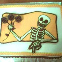 Scary Skeleton Halloween Cake Buttercream transfer skeleton, with black buttercream roses. Chocolate cake with chocolate filling.