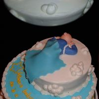 Surprise New Grandma Baby Cake This was my first paid cake, although I haven't gotten the money yet (we will see!). We surprised a co-worker with a baby shower, as...