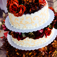 Fall In Love Fall themed Wedding Cake with fake flowers