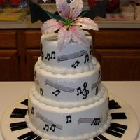 "Music Recital Reception Cake This buttercream frosted cake is made of 6"", 8"", and 10"" rounds, two per tier. All decorations are made of gumpaste and/or..."