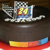 "Nascar Tire, Jeff Gordon This cake was fun to do and was ordered as a ""Just Because You are Special"" cake. Her fiance is a Jeff Gordon and NASCAR fan and..."