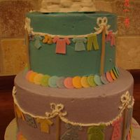 Clothes Line Baby Shower Lots of little baby clothes cut out of fondant. Clothes basket with baby clothes on the top.