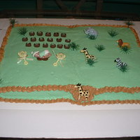 Jungle Baby Shower Cake is yellow w/buttercream frosting. Baby Boy was made with first impressions baby mold.