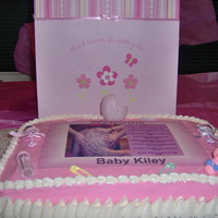 Welcome Baby Kiley Yellow cake with buttercream frosting. Picture and poem is edible image. Cake was made for a co-workers.