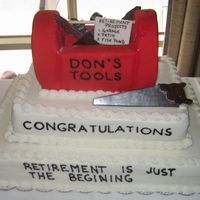 Tool Box Retirement Cake The tool box on top is made out of cake and covered with fondant. The tools were molded out of chocolate and covered with silver luster...