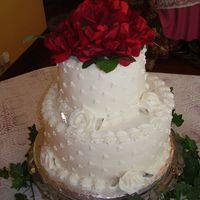 Round Wedding Cake   10 inch with a 6 inch on top. Silk flowers on top.