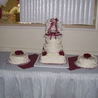 "15Yearcake.jpg This was my first quinceanera cake, It was all white cake with strawberry filling, 12"" square,10"" round and 8""round with two..."