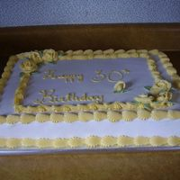 P1010068.jpg Half white half choc sheet cake in buttercream icing.
