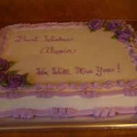 Purple And White Cake This cake is half white half choc for a girl leaving work. It has all buttercream icing.