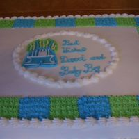 Baby Shower   This is a large half white half choc cake wtih buttercream icing.
