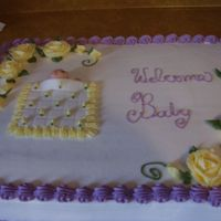 Baby Shower This is a white cake with buttercream icing.
