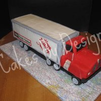 Tom's Semi-Truck Made with an 11X15 cake and then some leftover pieces for the cab. Buttercream and fondant with some painting with Nu-silver Luster Dust