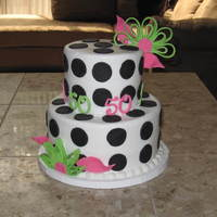 "Black And White 50Th Thank you Strazle for you design inspiration. Buttercream frosting with fondant dots. Modern quill-style flowers and ""50"" are..."