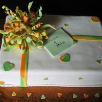 Gift Box Banana cake with brown sugar SMBC covered in vanilla fondant with gumpaste bow. For a bridal shower where the theme colors were orange,...