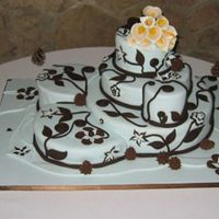 "Pine Cones And Cala Lillies This cake was inspired by Colette Peter's ""Chocolate Fantasia"" The central bottom tier (14 inches) and smallest tier (4..."