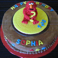 Elmo Chocolate Cake with chocolate filling. Fur done with fondant and a clay gun, which has got to be the hard way....