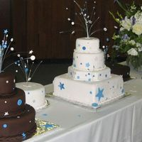 Stars And Dots Wedding cake for 350. Chocolate cake with chocolate meringue buttercream covered in chocolate fondant. Funfetti cake (from scratch) with...