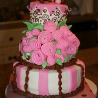 Fixed Pink & Brown Cake This is the after version of my Pink and Brown cake. I had to fix it with fondant roses when my gumpaste bow fell off and took half the...