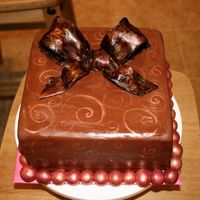 Chocolate And Gold Cake My seconf attempt at a gumpaste bow... Gold luster dust painte onto chocolate fondant.