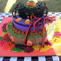 Halloween Cake My first attempt at a halloween cake... the pumpkin on top is fondant.