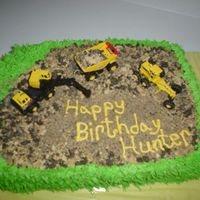 Construction Cake  yellow cake with pudding filling. Used grass tip. Graham crackers and oreos crushed for the dirt. I will not recomend writing on the...