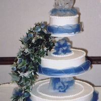 Steven & Corrie's Wedding Cake This was my first wedding cake. It was for my cousin & his wife. Corrie found this cake design on a website, I don't remember the...