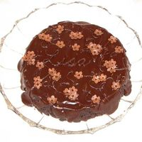 Flourless Chocolate Cake Birthday cake for my sister-in-law. Single-layer flourless chocolate truffle cake with a semi-sweet poured ganache glaze. Piping is ganache...