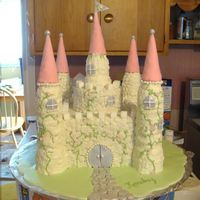 Buttercream Castle Cake This is my third castle cake. I didn't deviate much from my other designs except the towers are all edible this time. The towers are...