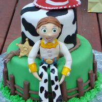 "Toy Story 2-Jessie Cake This was for my daughter's 3rd birthday. She loves the Toy Story movies and specifically requested a Jessie cake. Cake is 10""..."