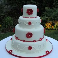 "Red And White Wedding Cake I made this for my cousin's wedding. Tier sizes are 14"", 11"", 8"", and 5"". Chocolate fudge with choc mousse filling..."