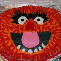 Animal Birthday Cake This is a sheet cake carved in the shape of Animal's face, his eyes, nose, mouth and teeth are all made from fondant and the rest is...