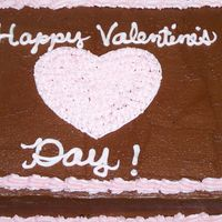 Happy Valentine's Day--Wilton Course 1 Practice Cake My class opted to do Valentine's cakes instead of the rainbow cake or character pans. Duncan Hines choc. fudge cake, torted and filled...