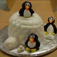 Penguin With Igloo My first attempt at MMF molding. White cake, MMF with carmel flavoring.