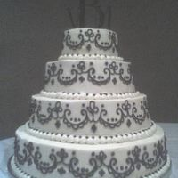 Brown Scroll Wedding Cake Bride picked this cake from a picture. lots of work! All white cake BC icing.