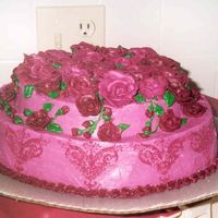 Burgundy Birthday Cake This is my MIL favorite color so I went all out for it. I used a metal embossing design for the side of the cake and spackled it on the...