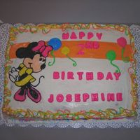 Minnie Mouse This is done with BC icing and is a vanilla cake. It is somewhat copied from an invatation I was given. The letters are chocolate.