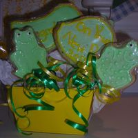 Frog Cookies  Came up with this,THANKS for all your HElp CC Members! Theres more frogs in the back and the lily pads say Congrats.....On your New Pad...
