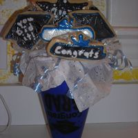 Graduation Cookie Bouquet I did this for our neighbour and blue & white are her school colours. They are sugar cookies with royal icing. Should I be using the...