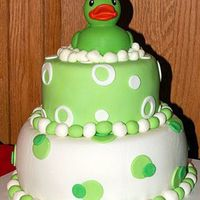 Green Rubber Ducky This is a cake made for my friend. I went looking for a yellow duck, but only found green. I then changed the whole cake idea to fit the...