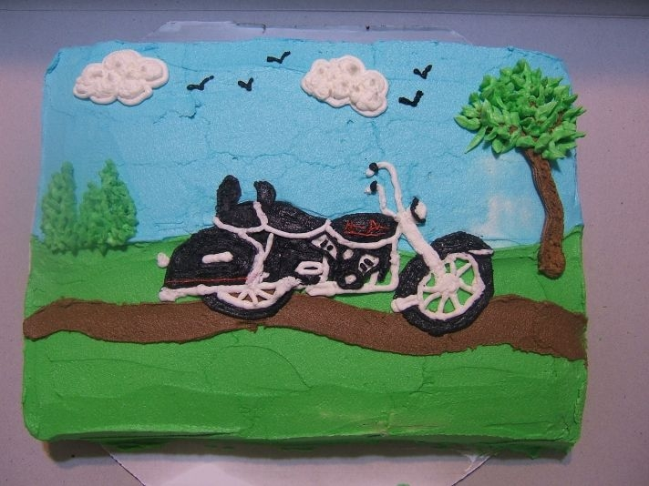 Allen's Bike Cake Freehand piped motorcycle and scenery