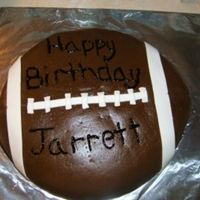 Football This is a half yellow half chocolate carved football cake, carved from 2 12inch cakes. Covered in mmf with mmf white accents, textured with...