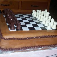 Chess Cake   I made this for my little brother. It was really hard to make the fondant cover the 16'' square. that was the worse part.