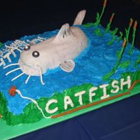 Catfish 7Th Birthday Made for my nephew who's nickname is Catfish! He loved the cake and it was a blast making it!!!!!1/2 choc, 1/2 white with BC , Royal...