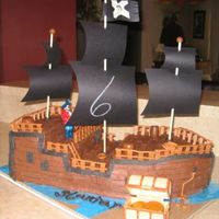 Pirate Ship I made this for my son's 6th Birthday. He loved it. My family does not like fondant so it's all BC with royal accents.. took...