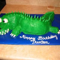 Alligator/crocodile Chocolate bundt cake with buttercream icing and MMF eyes and claws
