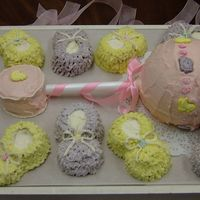 Rattle And Booties Shower Cake I used the Wilton ball pan for the rattle and the rest is made with cupcakes. I found bunny and duckie sweet tarts in the Easter candy...