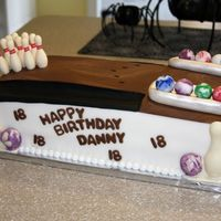 Bowling Cake made for my 18 year-old nephew's birthday. This was my first attempt at those candy mold things....the pins were candy as were...