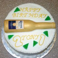 21St Birthday Cake - Corona Corona Bottle. Not particularily thrilled with the cake. The bottle is a gumpaste/fondant mixture that was laid over a corona bottle. The...