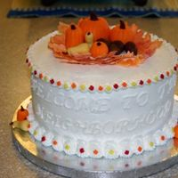 "Welcome To The Neighborhood For Our New Neighbors  2-layer, 9"" with buttercream. The pumpkins, squash and acorns are fondant. The tiny leaves on the borders are from the Wilton Fall..."